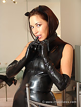 Sexy lady in latex cat suit looks amazing