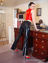 Red and black latex slut on a piano